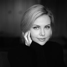 Charlize Theron - love her timeless beauty. If Hitchcock were still around, she'd be the leading lady in a whole news series of his films.