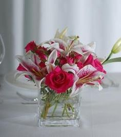 Stargazer Lily & Pink Rose Centerpiece | OneWed - sub in red rose