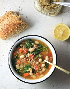 KALE, QUINOA + WHITE BEAN SOUP  Made single serving with: Garlic, Onion, 1/2 cup navy beans, About 1/3 cup leftover quinoa, 1 carrot, 1 celery, 2 cups veggie broth, Kale (until it looks good), 1/2 cup canned diced tomatoes