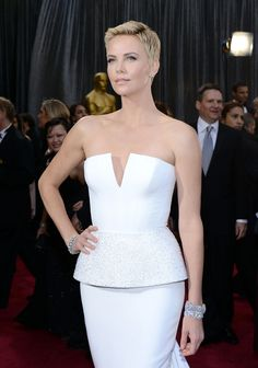 """2013 Academy Awards: Charlize Theron wore $4.5 million worth of Harry Winston diamonds including emerald-cut ear studs, a vintage 1959 58.07ct diamond lattice bracelet, a vintage 1959 """"Cluster"""" bracelet, a diamond marquise lattice bracelet, and marquise-cut diamond cluster ring, all set in platinum #AcademyAwards #diamonds #CharlizeTheron #HarryWinston #platinum"""