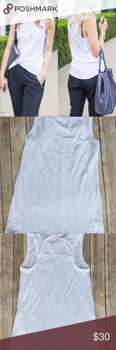 Athleta Shiva Tank 3 white NWOT condition 60%cotton and 40% polyester. Great for yoga, running and workout.... or just running errands in comfortable clothes! Athleta Tops Tank Tops