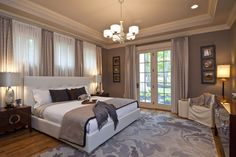 Design a cozy yet modern bedroom with a warm neutral.