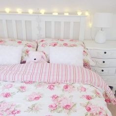 Floral bedding and fairy lights.