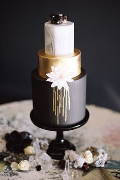 Marble, gold, black with gold drip 3 tiered dramatic cake.
