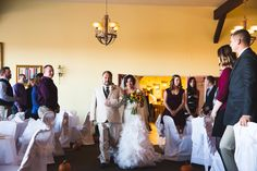 Ceremony in winery ballroom. Photo by Silver Photography.