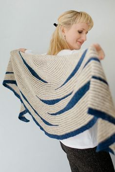 Justyna Lorkowska is one of my favorite indie designers. This is Masgot, a new shawl design that hugs your shoulders on chilly spring evenings, and I love the arbitrary placement of the dark blue intersections.
