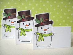 Table placecards made with HA snowman that comes with a matching die was used with the partial die cutting technique.