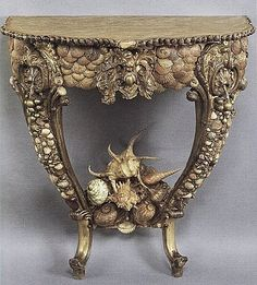 Coastal: shell art.  Beautiful shell encrusted table.