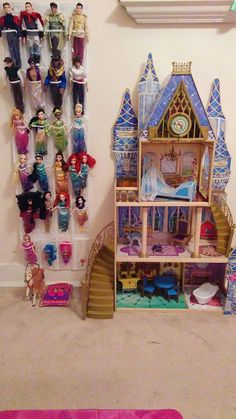 """Turned a shoe organizar into a barbie holder for my daughter! Now she has her barbies right next to her Cinderella Castle doll house!"""