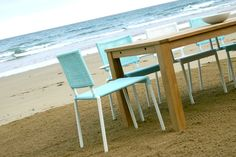 Antibes outdoor dining table shot on the beach with Lido chairs in blue and white. Dining Tables, Outdoor Dining, Contemporary Garden, Antibes, Garden Table, Teak, Outdoors, Blue, Home Decor