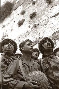 """David RUBINGER photography. Iconic photo from Israel's 6-day War 1967, paratroopers at the Western Wall. Shot from a low angle, the faces of (left to right) Zion Karasenti, Yitzak Yifat and Haim Oshri. Israeli author Yossi Klein Halevi calls it """"the most beloved Jewish photographic image of our time""""."""