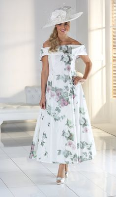 <p>Florentyna Dawn Stunning Off The Shoulder Floral Dress.<p> <p>As with any of the Florentyna Dawn label, length, sleeves etc., can be determined by each individual customer. Our customers have a choice of at least 5 jacket styles with each outfit.<p> <p>The colour palette for this fabulous style is simply phenomenal. (Both Plain and Patterned)<p> <p>We also provide all the matching hats, fascinators, shoes, handbags and jewellery if required.<p> <p>This stunning Florentyna Dawn special…