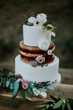 Unique jewel toned floral half-naked wedding cake | image by Jessie Schultz Photography