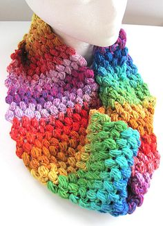 "This rainbow cowl may be my most favorite piece. With an all the shades of the rainbow yarn, it was crocheted with a pebble-like stitch. The colors just fade in and out of each other with great vibrancy. It measures 7"" (17.5cm) wide and is  definitely a statement piece and one of a kind! Wear it indoors or out and expect some attention!  It is a soft blend, acrylic yarn, no wool, so it can be machine washed cold and lay flat to dry. It has a cotton feel to it. Wear it for warmth but it ..."