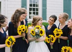 Nathan Westerfield Photography http://www.nathanwesterfield.com  Navy Bridemaids Dress, Sunflower Bouquet,