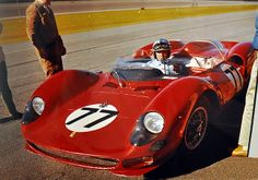 This is the 1965 Daytona 2000 Km. In the NART Ferrari 330 P2 is Pedro Rodriguez, who is adjusting his rear view mirror. The car would fail to finish due to a busted rear axle. His co-driver was John Surtees.