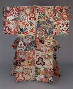 Noh theater robe with alternating blocks of color and design (dangawari) including stylized gongs (chôban), trailing clouds (kumo), crane roundels (tsuru), and lightening bolts (inazuma) in reddish-orange, blue, green, red, purple, white, brown silk and gilt paper-wrapped thread discontinuous supplementary patterning wefts; purple plain-weave silklining.