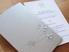 Snowflake Burst Invitation in silver and white.