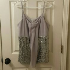 Like new sparkly top Sparkly top in perfect condition. Worn maybe twice. Charming Charlie Tops Tank Tops