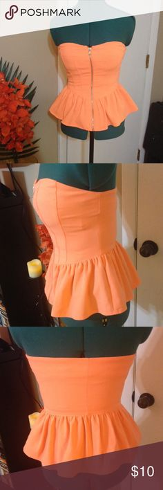 Forever 21 neon peach strapless peplum top Super cute strapless corset style peplum top. Pretty neon peach/orange, a little darker than pics in person, with front silver zipper. I bought this while in Hawaii, only worn a couple of times. Looks great with a tan😎 Forever 21 Tops