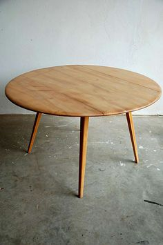 Ercol Round Dining Table  Designed by Lucien Ercolini, Britain  Round drop leaf dining table  Elm top with beech body