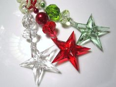 These festive and elegant beaded star Christmas ornaments are like jewelry for your Christmas Tree.    Lovely acrylic stars in Christmas