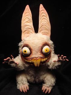 This is my idea of cute.  Creepy plush dolls by Santani.