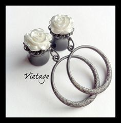 Vintage inspired etched hoops with dainty white and silver roses - elegant plugs for stretched gauged ears. $25.00, via Etsy.