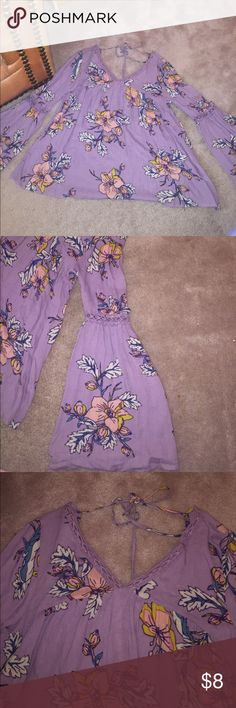 Purple floral peasant shirt Light purple shirt with orange and blue floral detail. Sleeves are fit and flare with detail above elbow. Ties on the back of the neck. Never worn!!!! Xhilaration Tops Blouses