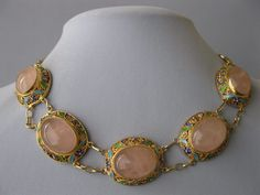 A 1950's Chinese Rose Quartz silver and enamel necklace.
