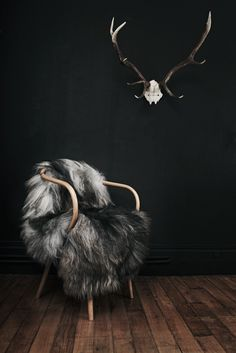 I love the dark bold colors in this decor. I love that it is bold yet earthy with wood tones, fur, and a skeleton.