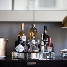 corral your bottles in a round, mirrored tray
