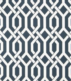 I like the graphic print on this fabric. Curtains for a home office & white furniture.