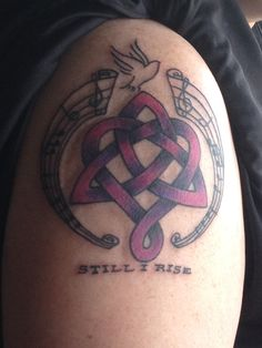 """My new tattoo that Katie designed.  The music are the songs I sang to the girls as babies. The Celtic symbol for family with our own twist at bottom for a ribbon for Chiari awareness. Dove of peace and our family motto """"Still I Rise""""!"""