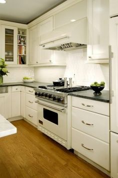 This transitional kitchen includes a customizable Viking range; options include a wide range of metal and color finishes. While the bright colors are tempting, the way this white range creates a clean and seamless look across the cabinets makes a good argument for matching the range to your cabinets.