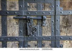 Ancient iron lock with latch on aged boarded door in Wurzburg, Germany. - stock photo