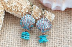 Bring these earrings to your summer beach vacation! These earrings are made with Thai burnished solid copper sea shell shaped charm. Patina is applied to the sea shell and polished by hand. There are