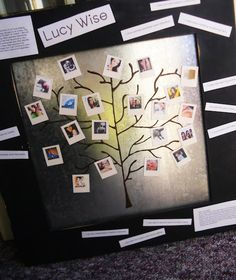 - i painted the tree on the magnet board, made mini polaroid magnets of family photos and wa-la!
