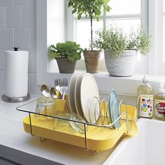Polder® Yellow Corkscrew Dish Rack in Utility & Kitchen Helpers | Crate and Barrel