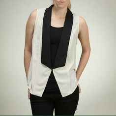 Sleeveless accent vest. Also available in sizes Small and Medium. Moon Collection Tops