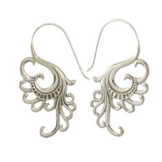 These lovely earrings sport a tribal motif on sterling silver with a fishhook clasp. Intricate details are hand-crafted for a unique look.
