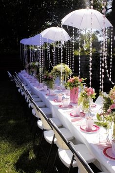 Oh the umbrellas! We did umbrellas over the table with twinkle lights for our Garden Party Murder mystery party - it could easily transfer to a Mystery in Wonderland or Murder in Wonderland mystery party as well!  The Garden Party Murder, Mystery in Wonderland and Murder in Wonderland are available at http://www.shotinthedarkmysteries.com