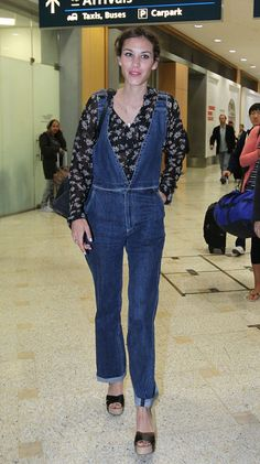 Alexa Chung shows dungarees are 'in' as she arrives in Sydney, Australia