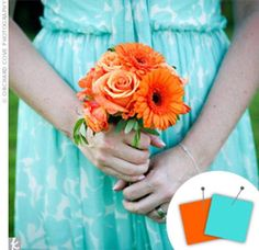 bridesmaid in an aqua dress carrying orange bouquet