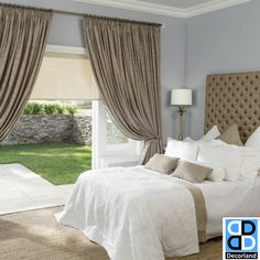 Create a statement with your window or french doors by using beautiful drapes in your bedroom