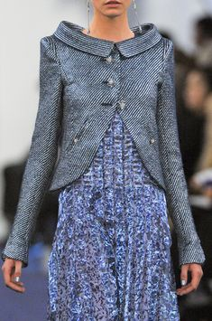 Idea to refashion old fashion jackets. Love the shape of the bottom of the jacket.
