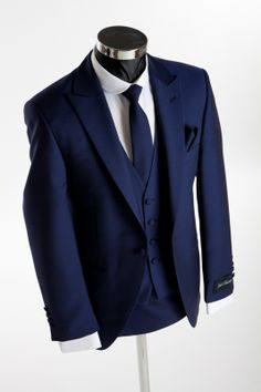 Slim fitting royal blue wedding suit May be a little too formal with the buttons as is and we could add in more color with shirt/tie/pocket square