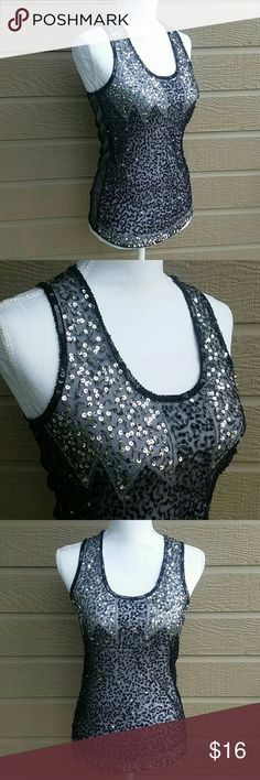 BKE black mesh sequin tank top BKE Boutique black sheer mesh tank top with front silver and black sequin design. No sequins appear to be missing, it is in great condition. Size SMALL. Bundle for a discount or make an offer! BKE Tops Tank Tops