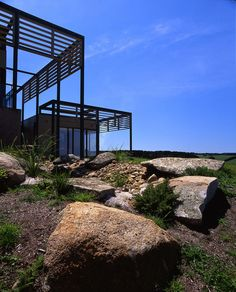 Rock garden and pond included in integrated landscaping for rural property in Flinders by B.E Architecture
