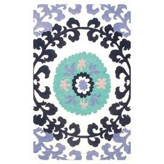 Indoor/outdoor rug with a suzani medallion motif.     Product: Rug    Construction Material: Polypropylene acrylic    Color: Blue, purple and white      Features: Suitable for indoor and outdoor use      Cleaning and Care: Clean with mild soap and garden hose     Note: Please be aware that actual colors may vary from those shown on your screen. Accent rugs may also not show the entire pattern that the corresponding area rugs have.